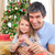 dad and little girl playing with christmas presents at home stock photo © wavebreak_media