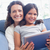 happy mother and daughter sitting on the couch and using tablet stock photo © wavebreak_media