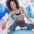 fit woman stretching leg in fitness studio stock photo © wavebreak_media