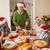 grandfather in santa hat carving roast turkey at christmas stock photo © wavebreak_media