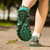 woman in running shoes jogging on path stock photo © wavebreak_media
