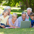 happy family using laptop in the park stock photo © wavebreak_media