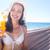 barna · hajú · megnyugtató · szalmakalap · tengerpart · nő · boldog - stock fotó © wavebreak_media