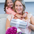 lánygyermek · meglepő · anya · ajándék · otthon · nappali - stock fotó © wavebreak_media