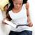 koncentrált · nő · olvas · könyv · kanapé · otthon - stock fotó © wavebreak_media