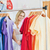 Merry blond woman choosing colorful clothes in a clothes store stock photo © wavebreak_media