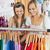 Animated female friends doing shopping in a clothes store stock photo © wavebreak_media