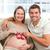 grávida · feminino · jogar · vermelho · sofá - foto stock © wavebreak_media
