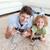 aranyos · fiú · játszik · videojáték · padló · otthon - stock fotó © wavebreak_media