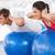 Fit couple exercising on fitness balls in gym stock photo © wavebreak_media