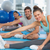 smiling people doing stretching exercises stock photo © wavebreak_media