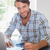sonriendo · jóvenes · masculina · tarjeta · de · crédito · cuaderno · ordenador - foto stock © wavebreak_media