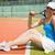pretty tennis player sitting on court smiling at camera stock photo © wavebreak_media