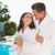 couple with champagne flutes by swimming pool stock photo © wavebreak_media