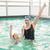 cute little girl learning to swim with coach stock photo © wavebreak_media