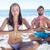 ioga · casal · relaxante · meditação · praia · silhuetas - foto stock © wavebreak_media
