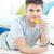 jonge · man · eten · afstandsbediening · vloer - stockfoto © wavebreak_media