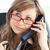 pensive businesswoman talking on phone wearing glasses against white background stock photo © wavebreak_media