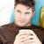 харизматический · молодым · человеком · Кубок · диван · гостиной - Сток-фото © wavebreak_media