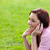 Delighted young woman on phone sitting on the grass stock photo © wavebreak_media