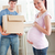 adorable pregnant woman with husband holding cardboard in the kitchen of their new house stock photo © wavebreak_media