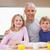 улыбаясь · отец · позируют · детей · утра · кухне - Сток-фото © wavebreak_media