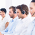 Business colleagues with headsets in a row stock photo © wavebreak_media