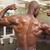 rear view of shirtless muscular man flexing muscles stock photo © wavebreak_media