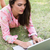 pretty brunette using laptop in park stock photo © wavebreak_media