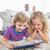 testvérek · digitális · tabletta · szőnyeg · boldog · szülők - stock fotó © wavebreak_media