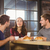 friends talking and enjoying coffee and croissants stock photo © wavebreak_media