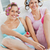 Cheerful female friends doing pedicure and wearing hair rollers at home stock photo © wavebreak_media
