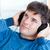 aantrekkelijk · jonge · man · luisteren · muziek · vergadering · woonkamer - stockfoto © wavebreak_media