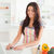 good looking woman relaxing with her laptop while standing in the kitchen stock photo © wavebreak_media