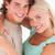 Close up of a happy couple smiling in a studio stock photo © wavebreak_media