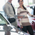 Salesman and a woman standing next to a car in a car shop stock photo © wavebreak_media
