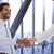 composite image of two businessmen shaking hands in office stock photo © wavebreak_media