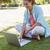 pretty woman using laptop in park stock photo © wavebreak_media