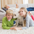 cute silblings with their puppy on rug stock photo © wavebreak_media