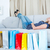nő · ül · bevásárlótáskák · nappali · kanapé · vásár - stock fotó © wavebreak_media