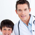 Portrait of a little boy and his doctor stock photo © wavebreak_media