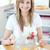 delighted woman preparing a cake in the kitchen stock photo © wavebreak_media