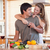 lovely couple drinking wine while hugging in their kitchen stock photo © wavebreak_media