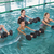 souriant · s'adapter · femme · aérobic · piscine - photo stock © wavebreak_media