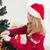young woman decorating a christmas tree stock photo © wavebreak_media