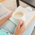 woman reading and drinking coffee on couch stock photo © wavebreak_media