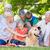 happy family petting their dog in the park stock photo © wavebreak_media
