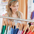 Captivating young woman choosing a colorful shirt in a clothes store stock photo © wavebreak_media