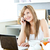 Young caucasian woman using her laptop and talking on phone during breakfast in the kitchen at home stock photo © wavebreak_media