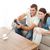 Attentive couple playing video game together in the living room at home stock photo © wavebreak_media